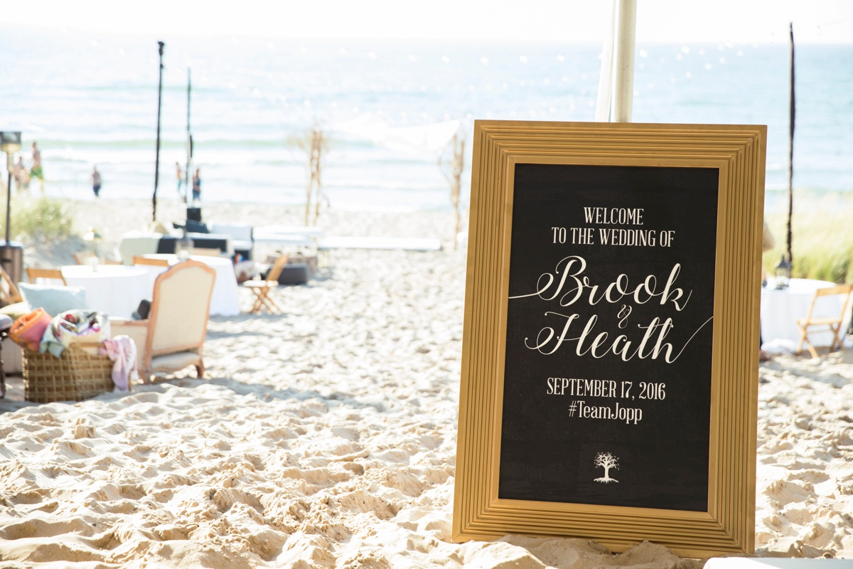 Beautiful hand-lettered sign at Brook and Heath's South Haven wedding