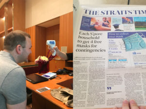 COVID temperature taking and Singapore news about masks